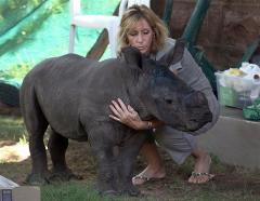 Ntombi with her caregiver at the Rhino Orphanage.