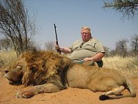 This man didn't even have to leave the jeep to shoot this unforuntate lion.
