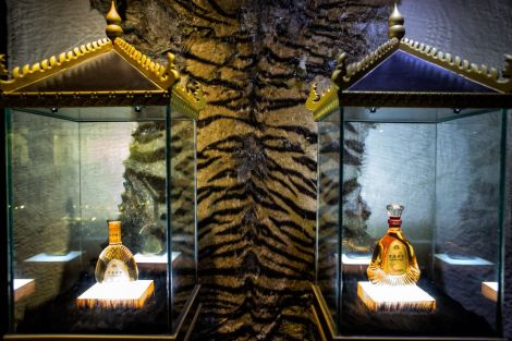 A shop displays tiger bone wine, sold in ornate bottles, and a tiger pelt hung on a wall. To make the liquor, thought to distill the vitality of wild tigers, skeletons are marinated in tanks filled with alcoholic tonic. In Mong La, Chinese men imbibe it as an aphrodisiac and then head to the many bordellos.