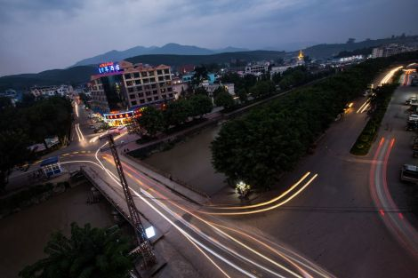 As night falls, traffic slides through the center of Mong La, which is bisected by a caramel-colored river. The town, in an area that is mostly jungle, has grown as China's middle class has expanded and sought out its illicit pleasures.